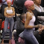 Rihanna sports a new pink hairstyle at The Clippers game